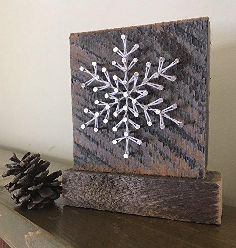 """Sweet & Small freestanding wooden snowflake """"frosty"""" string art decor sign. Perfect for holiday home accents, ski cabins and and snowflake gifts for winter enthusiasts by Nail it Art. from Nail it Art"""