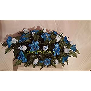 Beautiful Light Blue Roses With Blue Buttercups Cemetery Saddle Funeral Arrangement 3