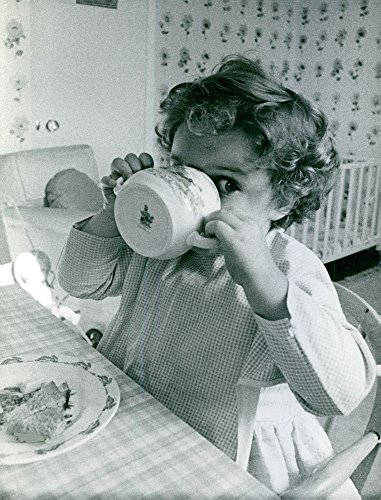 (Vintage photo of Princess Margaretha, Mrs. Ambler39;s child drinking from a cup.)