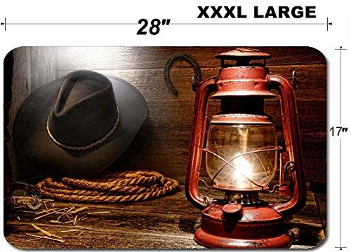 Liili Large Table Mat Non-Slip Natural Rubber Desk Pads IMAGE ID: 15544339 Vintage kerosene lantern lamp illuminating American West rodeo cowboy gear with hat