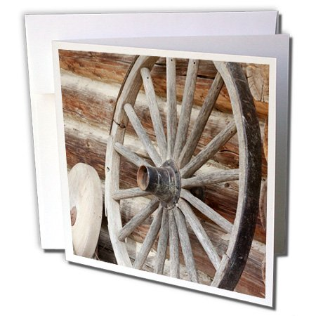 3dRose Danita Delimont - Jaynes Gallery - Wheels - Canada, Fort Steele. Wagon wheel, grinding stone, and log cabin. - 12 Greeting Cards with envelopes -