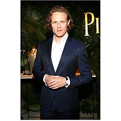Sam Heughan Hands Clasped Looking Dapper in Suit 8 x 10 inch Photo