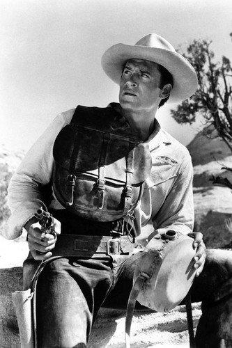 Clint Walker Western pose holding gun and water canteen 11x17 Mini Poster by Silverscreen