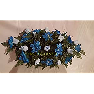 Beautiful Light Blue Roses With Blue Buttercups Cemetery Saddle Funeral Arrangement 120