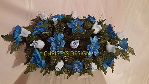 Beautiful-Light-Blue-Roses-With-Blue-Buttercups-Cemetery-Saddle-Funeral-Arrangement