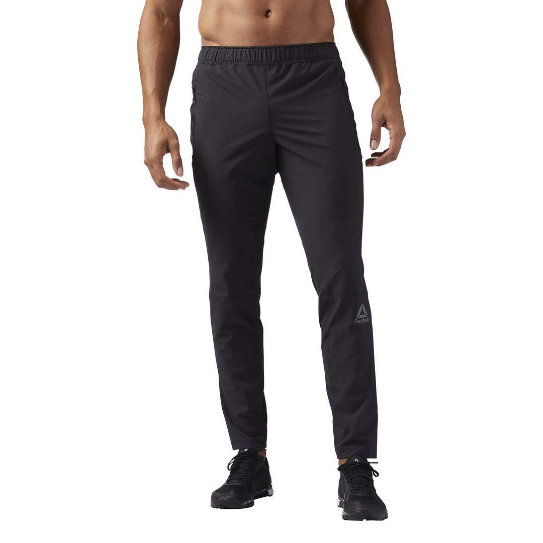 741cfe86 Amazon.com: Reebok Men' Speedwick Woven Trackster: Clothing