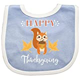 Say Happy Thanksgiving with this adorable Baby Bib that has a squirrel with acorn and leaves.