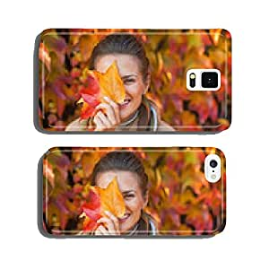 Portrait of happy young woman hiding behind autumn leafs cell phone cover case Samsung S5