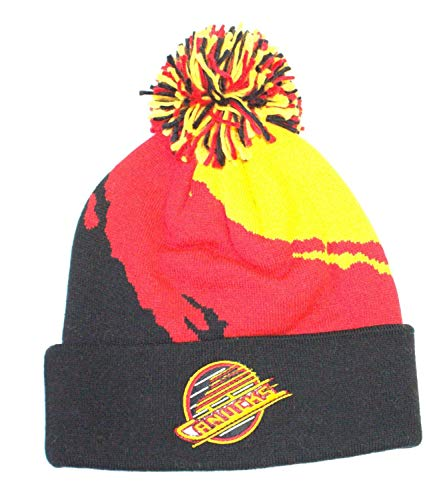 1e423cf9e5d Mitchell   Ness Vancouver Canucks NHL Vintage Paintbrush Cuffed Pom Knit Hat
