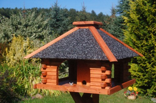 Bird Feeder With A Roughcast Roof