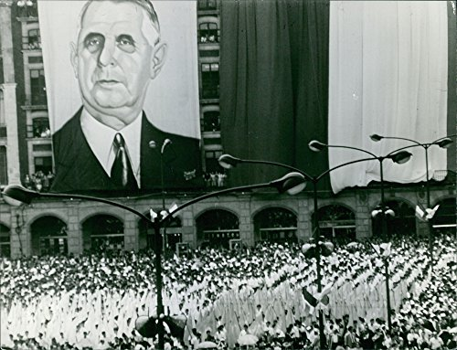 Vintage photo of A big poster of Charles de Gaulle hanging on the building, 1964. -