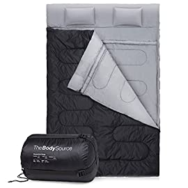 """Active Era Double Sleeping Bag – Water Resistant and Lightweight Queen Size with 2 Pillows & Compression Bag, Converts into 2 Singles – 3 Seasons 32F, Perfect for Camping, Hiking, Outdoors & Travel 1 LARGE DOUBLE DESIGN – The large double sleeping bag (87"""" x 60"""") is suitable for a queen size bed and can be easily converted into two single sleeping bags for dual usage. It also comes with 2 pillows for added comfort, helping you get a great night's sleep wherever you may be WARM 250GM FILLING – The sleeping bag has a warm 250GSM hollow fibre filling making it great for indoor use or year-round as a 3 season sleeping bag. It has a comfort temperature range of 50°F to 32°F and extreme use down to 23°F COMPACT & LIGHTWEIGHT – Designed with the perfect warmth to weight ratio the sleeping bag will keep you warm and comfortably at night & includes a water-resistant outer shell, a WIND-PROOF zipper system and internal drawstring collar for added protection from the elements"""