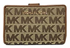 Michael Kors Jet Set Travel Bifold Zip Coin Wallet is made of dual tone monogram printed jacquard fabric with polished hardware. It features a front accordion compartment that zips along the left side and across the top with an accordion plea...