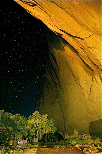 Photograph of Canyon Wall at Night with Ancient Anasazi Indian Ruins and Stars From Canon De Chelly National Monument, Arizona.