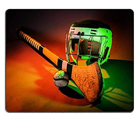Liili Natural Rubber Mouse Pad Hurling Ball Close Up a studio shot of a hurling stick ball and helmet in colorful green and orange IMAGE ID (Ottoman Helmet)
