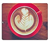 MSD Natural Rubber Mousepad cup of coffee latte art on the wooden desk IMAGE 36592304