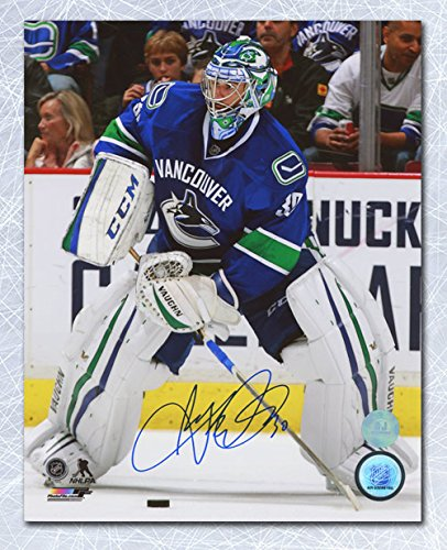 AJ Sports World Ryan Miller Vancouver Canucks Autographed Passing The Puck 8x10 Photo ()