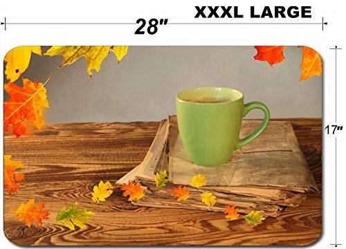 Liili Large Table Mat Non-Slip Natural Rubber Desk Pads Cup of tea with autumn leaves reflection on newspaper wood Image ID 22759699