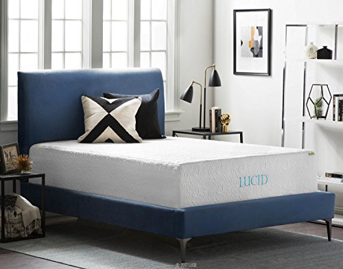 LUCID hybrid mattress with 2 multicolored pillows in a blue colored platform bed in a room with framed pictures, night lamps, and other items