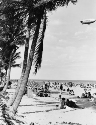 c1933 photo Beach scene with palm trees in foreground and Goodyear blimp above / photo by G.W. Romer, Miami, Fla. Vintage 8x10 Photograph - Ready to - Beach Miami Scene