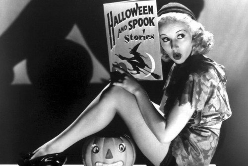 Betty Grable posing by pumpkin Halloween book 24x36 Poster]()