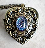 German Helio Cabochon Music Box Locket.