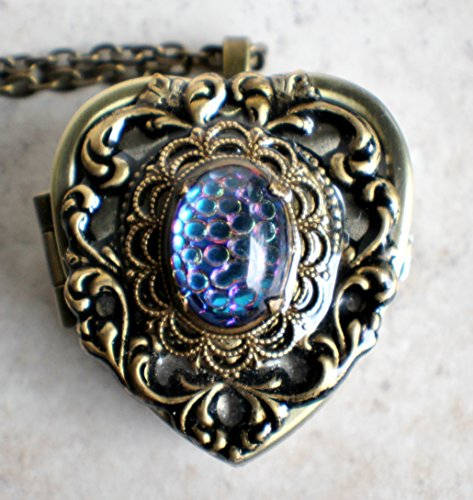 German Helio Cabochon Music Box Locket. (Helios Art)