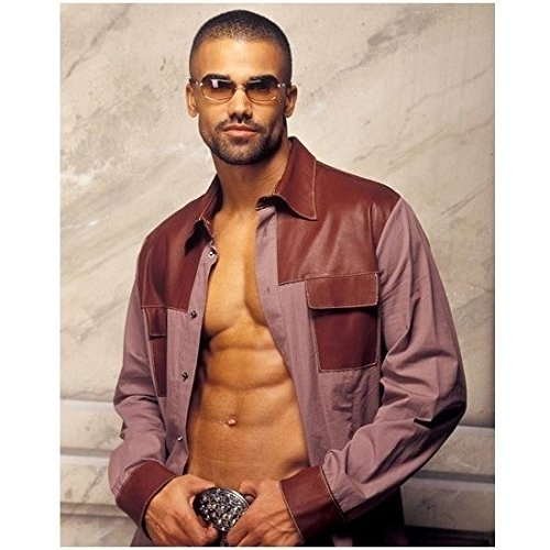 (Criminal Minds Shemar Moore with shirt open holding belt buckle 8 x 10 Inch Photo)
