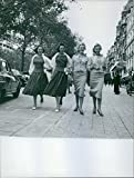 """Size Size of photo 7.2"""" x 9.5""""  A photo of popular twins in Europe Alice and Ellen Kessler walking with another twin sisters.Alice and Ellen Kessler are popular twins in Europe, especially Germany and Italy, from the 1950s and 1..."""