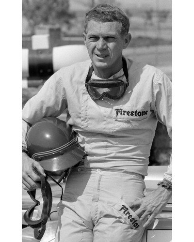 Steve McQueen in Firestone racing outfit holding helmet 11x14 Promotional Photograph