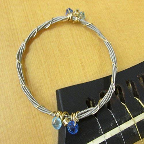 - RECYCLED GUITAR STRING BRACELET WITH SAPPHIRE AND AQUAMARINE SWAROVSKI CRYSTAL