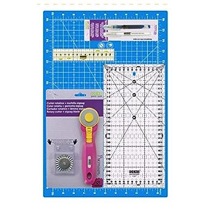 Kit básico para patchwork. Incluye: 1 base de corte 45x30 cm | 1 regla