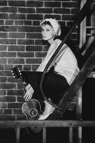 Audrey Hepburn 24x36 Poster Breakfast at Tiffany's with guitar on porch ()