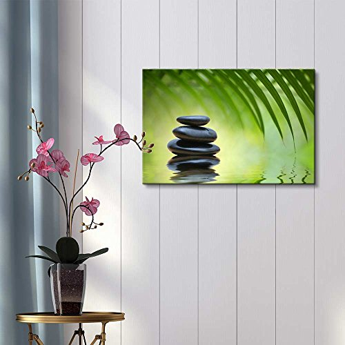 Green Bamboo Leaves Over Zen Stones Pyramid Reflecting in Water Surface for Spa Decor Wall Decor