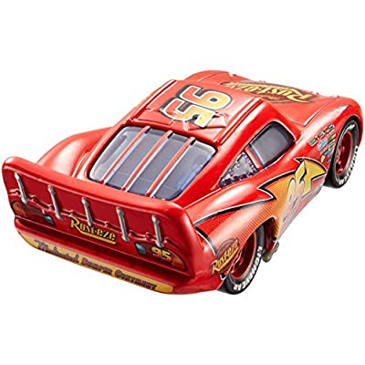 Disney Pixar Cars Movie Moments Lightning McQueen with Pit Stop Barrier Vehicle: Toys & Games