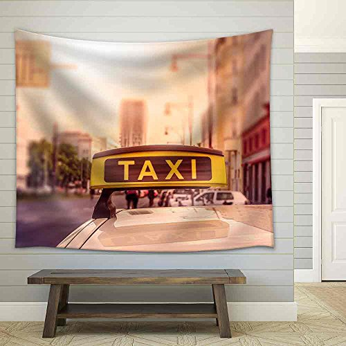 Taxi Sign on Top of a German Cab in the Evening Sun Intentional Selective Focus Fabric Wall Tapestry