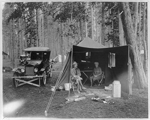 1923 Photo Lake Public auto camp party (E. S. Bach) man and woman sitting in tent camping among the trees with automobiles and other tents near by. Location: Yellowstone National Park
