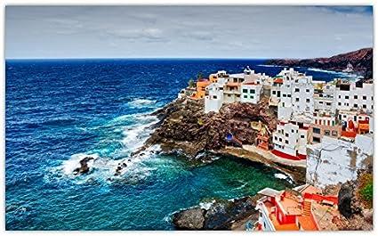 playa-la-caleta-de-arriba-spain-las-islas-canarias-canary-islands-ocean-rocks-cliff-coast-house sitios de viajes postal Post tarjeta: Amazon.es: Oficina y papelería