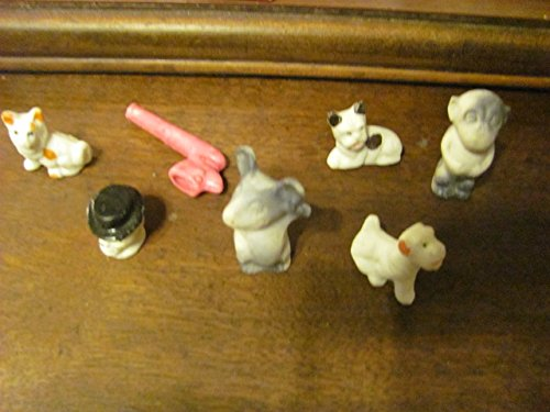 7 circa 1940s miniature bisque figurines, dogs, skull, monkey, etc