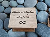 Custom engraved wooden music box with your names on the top along with your special date and an infinity symbol