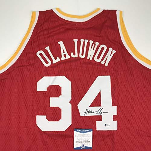 - Autographed/Signed Hakeem Olajuwon Houston Red Basketball Jersey Beckett BAS COA