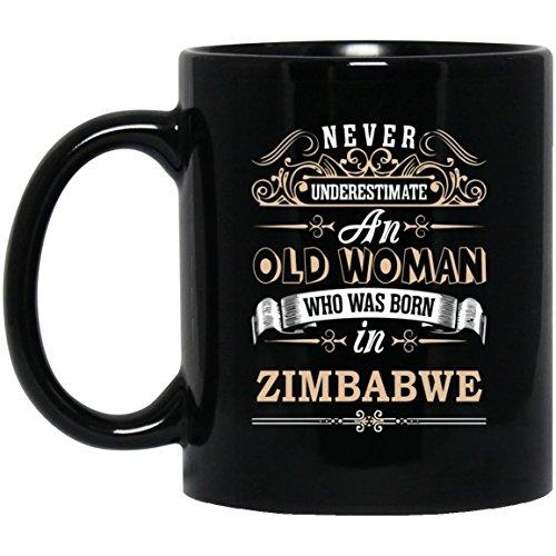 ZIMBABWE Coffee Mug - Never Underestimate an Old Woman Born in ZIMBABWE - Great ZIMBABWE Gift Idea for Women, Sister, Girlfriend - On Christmas, Birthday - 11 Oz Tea Cup Black