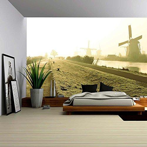 Traditional Dutch Windmills at Dawn in Kinderdijk Netherlands