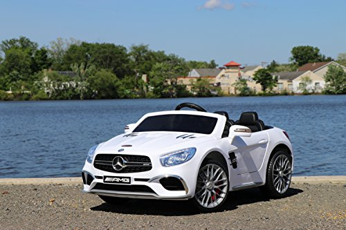 - First Drive Mercedes Benz SL65 White 12v Kids Cars - Dual Motor Electric Power Ride On Car with Remote, MP3, Aux Cord, Led Headlights, and Premium Wheels