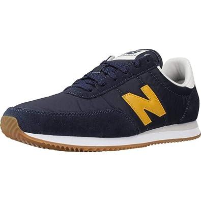 new balance azul y amarillo hombre