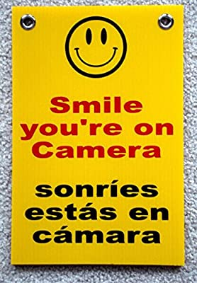 """1-Pc Blameless Popular Smile You're On Camera Security Signs Protection Surveillance Warning Size 8""""x12"""" with Grommets Spanish"""