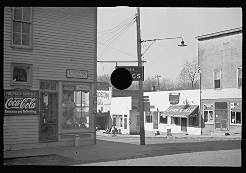 Pump, oilcan cut in half used as trough, Nashville, Brown County, Indiana