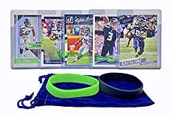 The Seahawks are red hot! This lot of five 2006-2018 Seattle Seahawks football cards makes a great gift and collectors item for any Seahawks fan. Guaranteed to include one card each of Russell Wilson, Chris Carson, Doug Baldwin, Tyler Lockett and Bob...