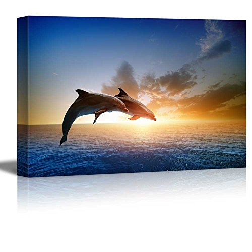 Beautiful Scenery of Two Jumping Dolphins on the Sea at Sunset Wall Decor