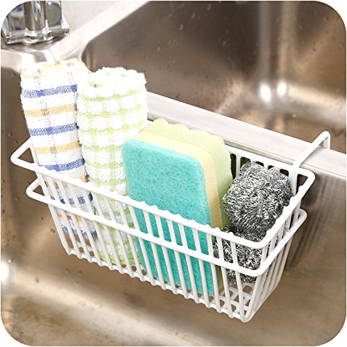 A drainage storage fixed on a sink is used to keep sponge,small kitchen towels in the image.
